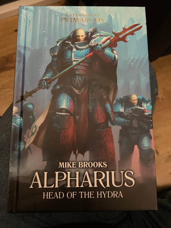 A photo of the front cover of the book Alpharius: Head of the Hydra, by Mike Brooks, taken shortly after I had finished reading it.